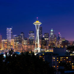 Seattle's space needle light by the glow of the lights from the city below