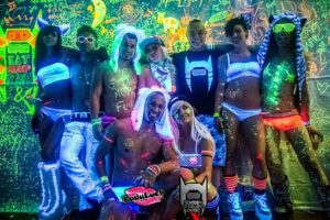 Members of Sensory Overload Empire and Lady Luck Productions at the last Neon Paint Party. Front and center: Nick Abarca (left) and Arielle Zippi. Top left to top right: Kelly Eubanks, Jake Smith, Chris Elisarraras, Leighann Graham, Drew Miyahara, Desirae Yvonne and Robert Petersen.